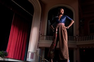 A model wearing an outtfit from Brenau fashion merchandising student Candice Jenkins' line 'Freedom' stirkes a pose at the end of the catwalk in the historic Pearce Auditorium on Brenau University's Gainesville campus.