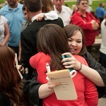 Melissa Waldrop is greeted by family and friends outside of Pearce Auditorium after Waldrop was pinned during the Brenau University School of Nursing's pinning ceremony.