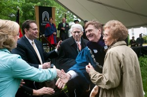 Brenau University President Ed Schrader shakes hands with the family of Richard and Phyllis Leet, who were given honorary degrees for community service and service to Brenau during the 2013 commencement ceremonies. Richard Leet is a Brenau Trustee.