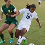 Brenau's Vanessa Alexander beats Belhaven's Ashley Ventura to the ball during Thursday's match.  Alexander added one gaol to Brenau's 5-0 shutout against the Blazers.