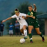 Brenau's Elizabeth Campbell fights for possession against Belhaven's Jordan Organ during Thursday's match.