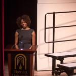 Brenau's Lea Mason introduces the winter convocation speaker Mrytle Figueras