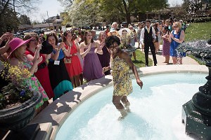 Monique Purnell smiles after she was thrown into the fountain by her sorority sisters and fellow Brenau University students after the fountain was dedicated in memory of Grace Hooten Moore, a Brenau alumna and former Board of Trustees member. Traditionally, students are thrown into the fountain after they are engaged.